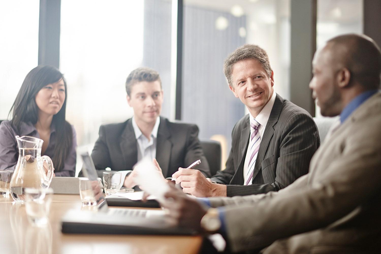 business development professionals working - HD1200×800